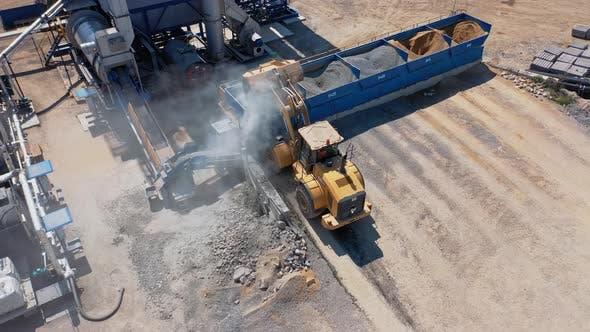 Bulldozer Working with Gravel Outdoors