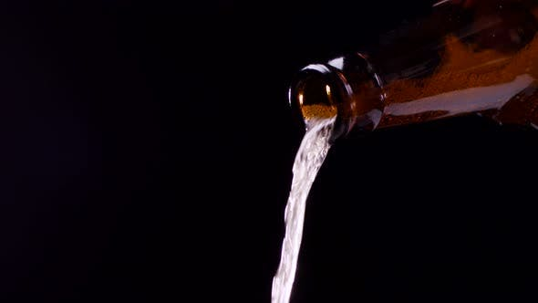 Thumbnail for Beer Pouring From Bottle on Black Background
