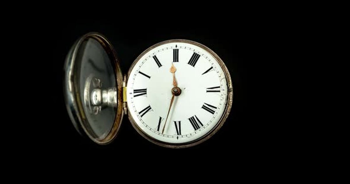 Running Second Hand on an Old Pocket Watch with a White Dial. Close Up. Timelapse . Back Background