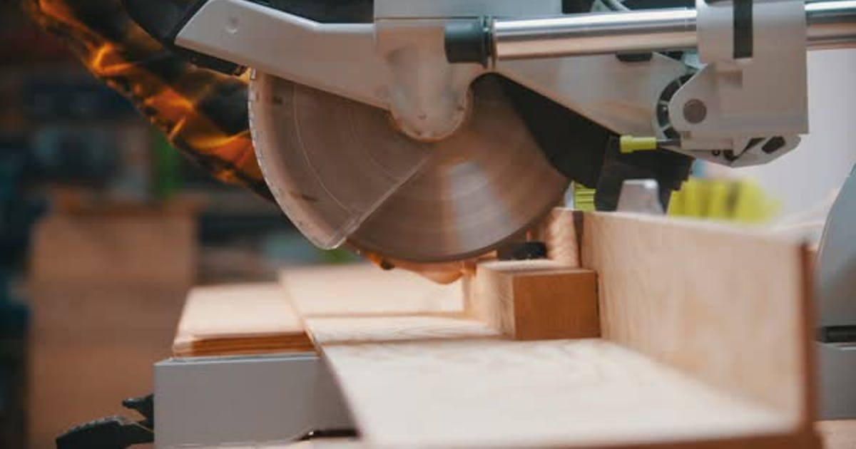 Woodworker Cutting the Wooden Detail with a Circular Saw