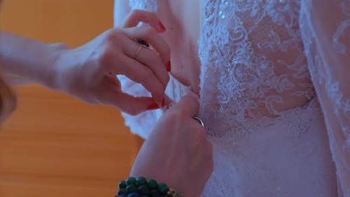Buttoning on the Wedding Dress.