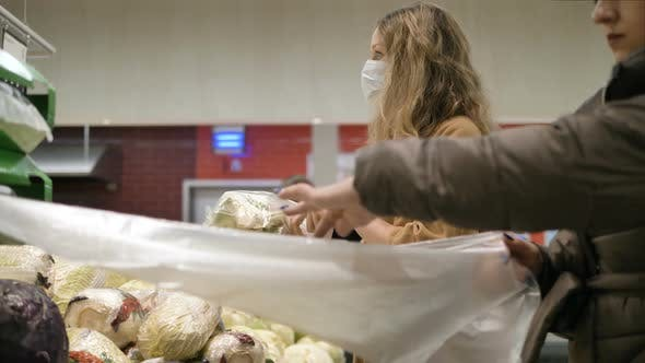 Thumbnail for Woman in a Medical Mask Buys Cauliflower in a Supermarket