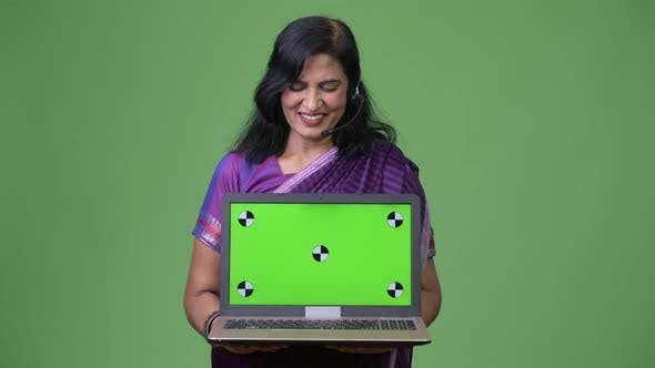 Thumbnail for Mature Happy Beautiful Indian Woman As Call Center Representative Showing Laptop