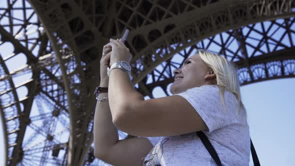 Thumbnail for Happy Woman Making Video Call Under Eiffel Tower