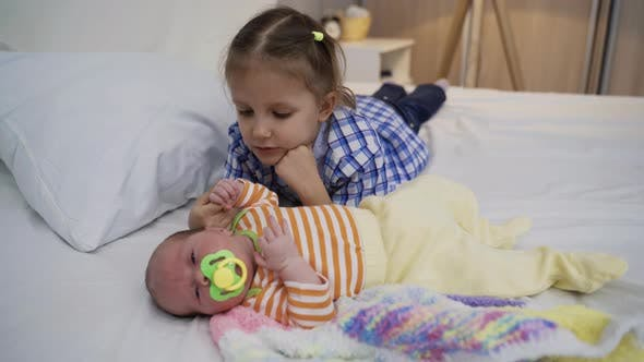 Thumbnail for Girl Child Five Years Age Playing With Newborn Sister