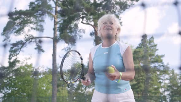 Cover Image for Successful Happy Mature Woman Won the Tennis Tournament