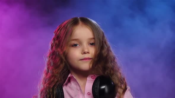 Thumbnail for Little Girl Dj Playing on Vinyl. Colored Smoke, Slow Motion