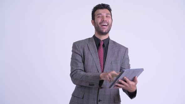 Thumbnail for Happy Bearded Persian Businessman Using Digital Tablet