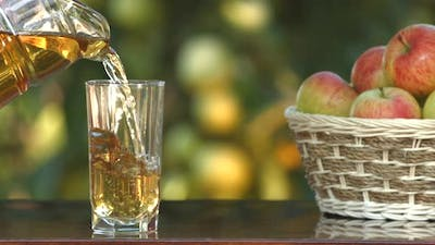 Apple juice and basket with apples