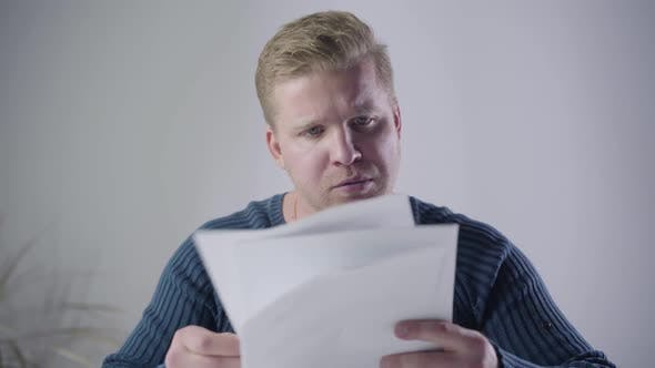 Thumbnail for Close-up of Dissatisfied Caucasian Man Looking Through Documents and Throwing Them Away. Annoyed