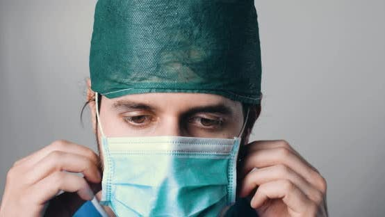 Thumbnail for Tired Doctor Takes off his Mask