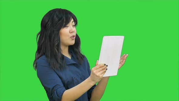Thumbnail for Asian Business Lady Chatting Using a Tablet on a Green Screen Chroma Key