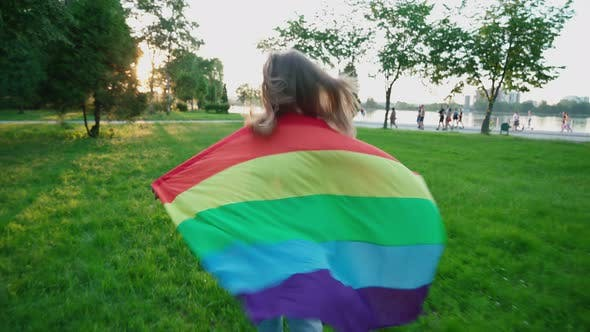 Thumbnail for Woman Running with Rainbow Flag, Showing Tolerance.