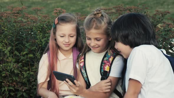 Thumbnail for Happy Kids Enjoying Video on the Phone.