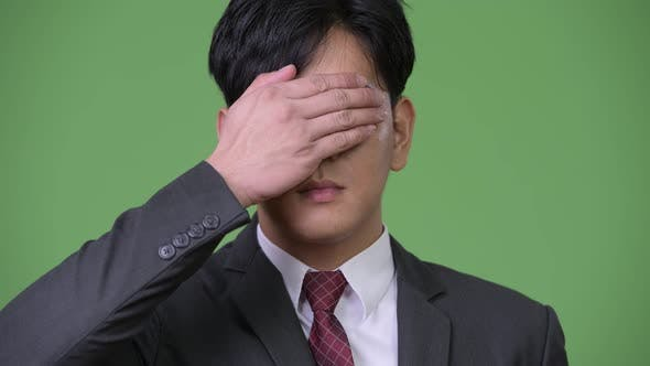 Thumbnail for Young Handsome Asian Businessman Covering Eyes As Three Wise Monkeys Concept