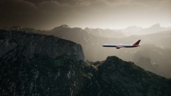 Thumbnail for Passenger Aircraft Over Mountain Landscape