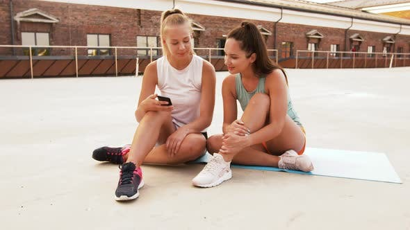 Thumbnail for Sporty Women or Friends with Smartphone on Rooftop
