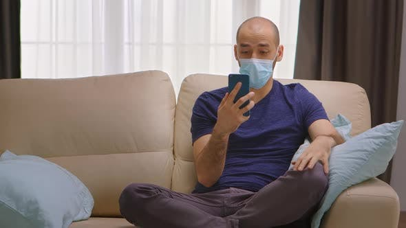 Thumbnail for Man with Protection Mask on a Video Call