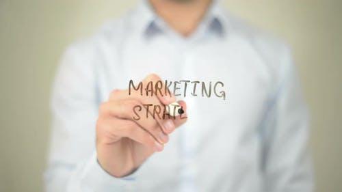 Marketing Strategy, Businessman Writing on Transparent Screen