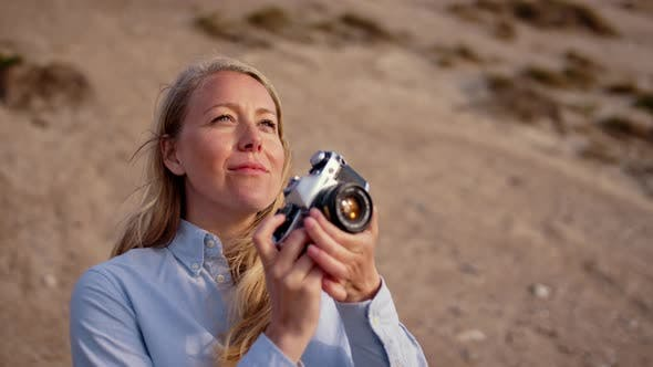 Photographer Focusing Slr Camera