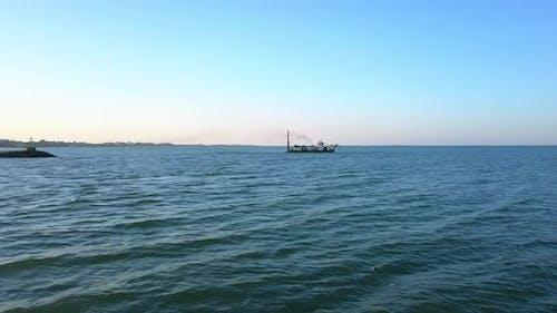 Boat for the Beach Nourishment on the Sea