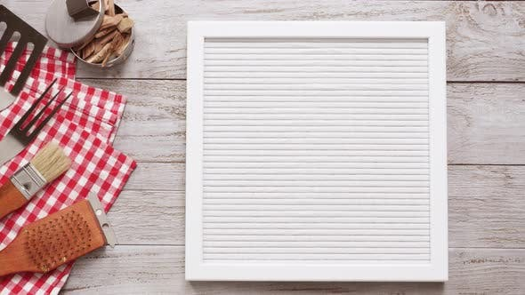Thumbnail for BBQ Time sign on memo board with BBQ tools.
