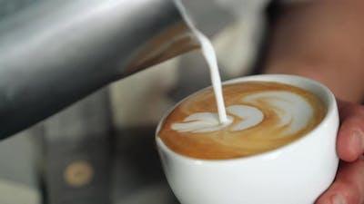 Barista Making of Cafe Latte Art