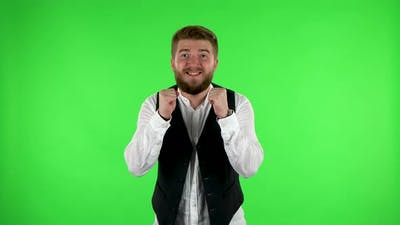 Man Looking at Camera with Anticipation, Then Very Upset. Green Screen