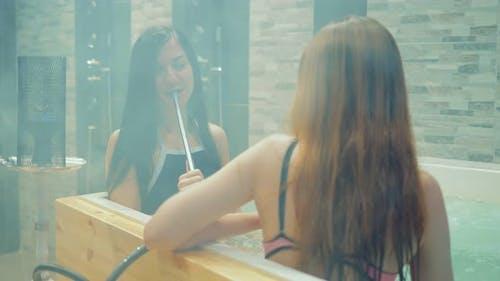 Sexy Girls Smoke Hookah in the Pool