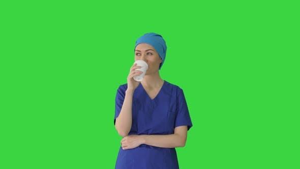 Thumbnail for Smiling Female Doctor or Nurse in Blue Uniform Having a Coffee Break on a Green Screen, Chroma Key