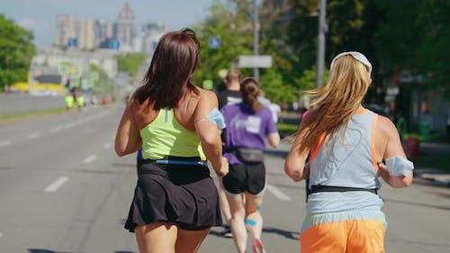 Body Positive Women Running Marathon in Slow Motion