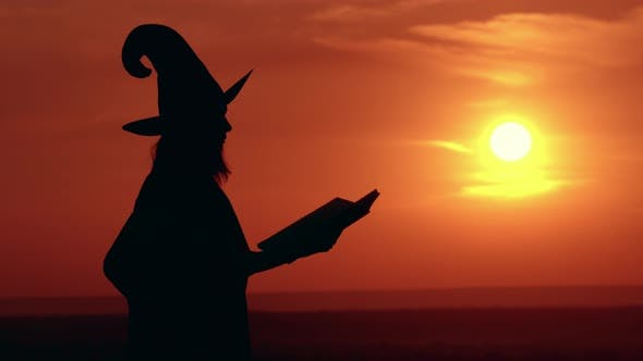 Thumbnail for Girl in Fancy Dress and Hat Witch Conjures Hold Big Magicbook Sunrise View