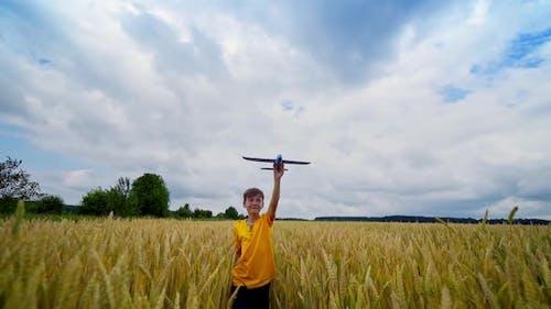 Little boy playing on field