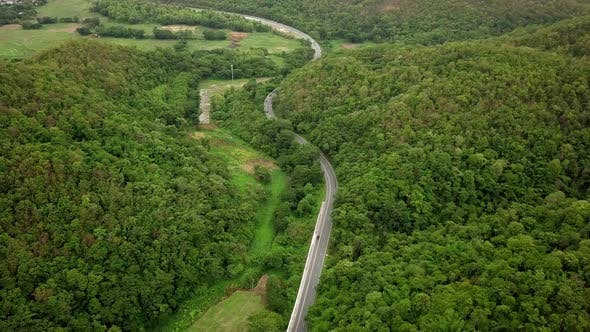 Cover Image for Aerial View Of Countryside Road Passing Through The Mountain Landscape