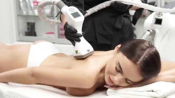 Lovely Female Customer of Beauty Clinic Receiving Beauty Shape Procedure