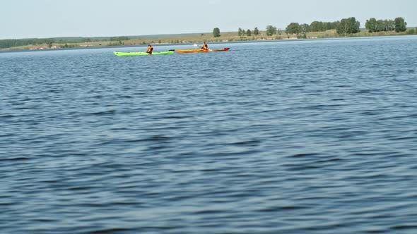 Thumbnail for Two Kayakers Rowing on Lake