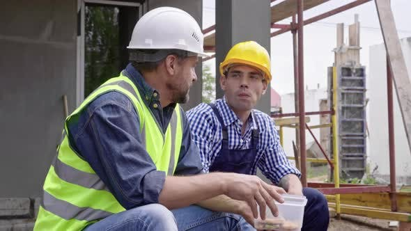 Thumbnail for Two Male Engineers Eating at Work
