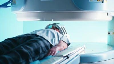 Elderly Patient During Futuristic MRI Procedure