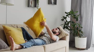 Bored Man With Pillow