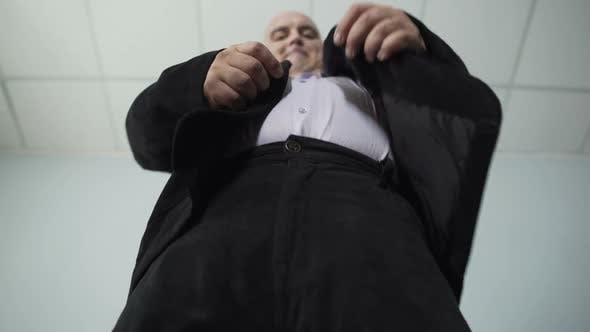 Thumbnail for Funny Obese Man In Classic Suit Fastening A Button On His Jacket, Overweight