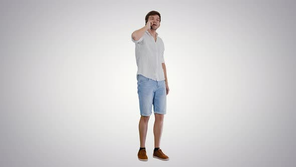 Thumbnail for Happy Young Man Talking on Mobile Phone and Smiling on Gradient Background