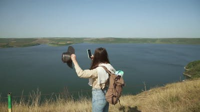 Woman Taking Photos on Smartphone of Bakota Area