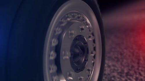 Close-up of a car wheel riding on asphalt