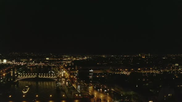 Thumbnail for AERIAL: View Over Seine River in Paris, France at Night with Shining City Lights