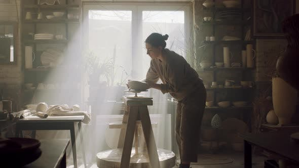 Woman Is Taking Raw Clay Pot Off Pottery Wheel