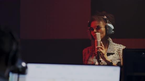 Thumbnail for Female Singer in Recording Studio