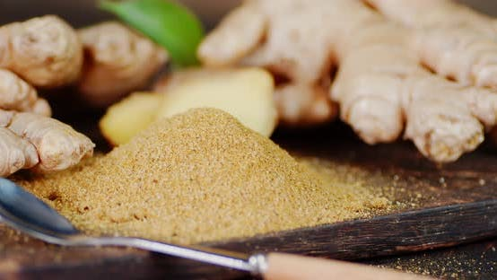 Ground Ginger Powder on the Cutting Board Rotates Slowly