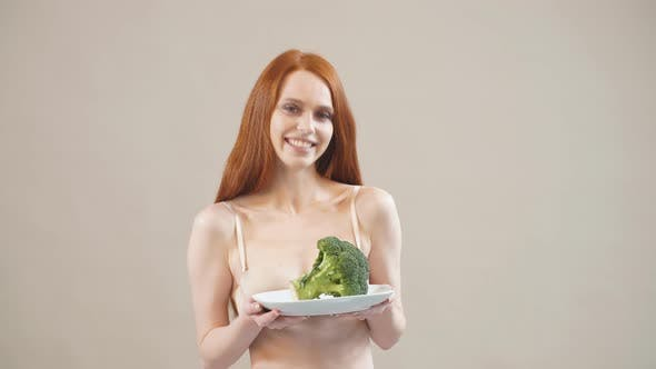 Thumbnail for Joyful Skinny Girl Keeps Broccoli in a Plate, Afraid of Excess Weight, Anorexia