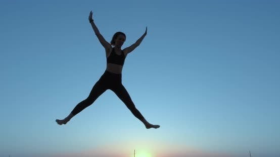 Thumbnail for A Girl Jumps High on a Trampoline. Against the Sky. Active Lifestyle