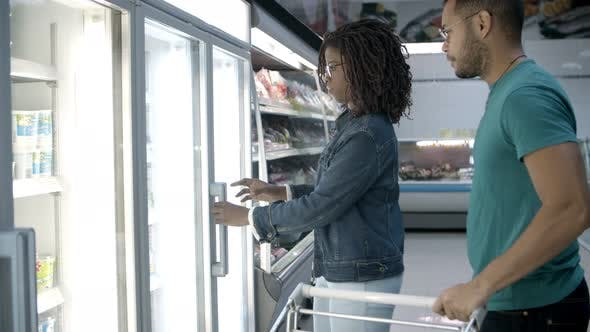 Thumbnail for Focused African American Couple Buying Food at Grocery Store